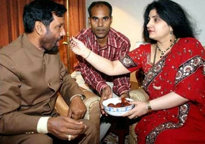 Reena Paswan offering a sweet dish to Ram Vilas Paswan