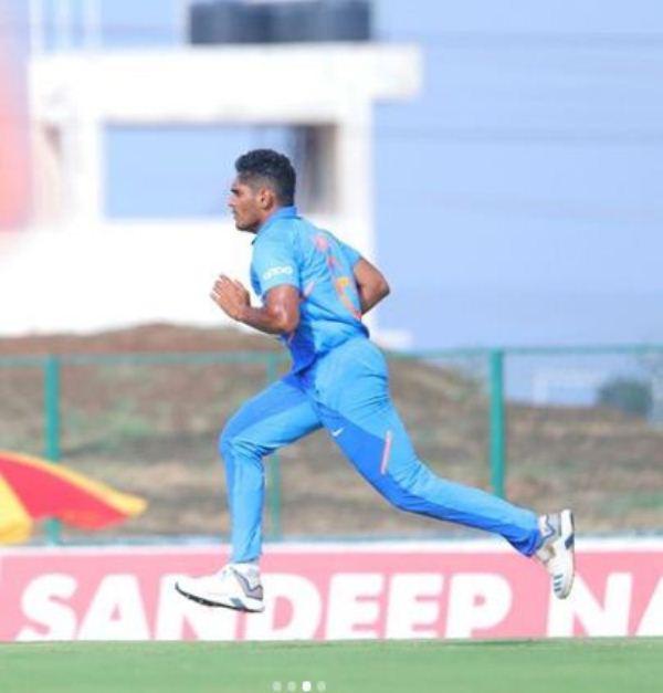 Tushar Deshpande bowling during an India A match
