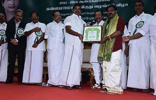Velmurugan Receiving an Award