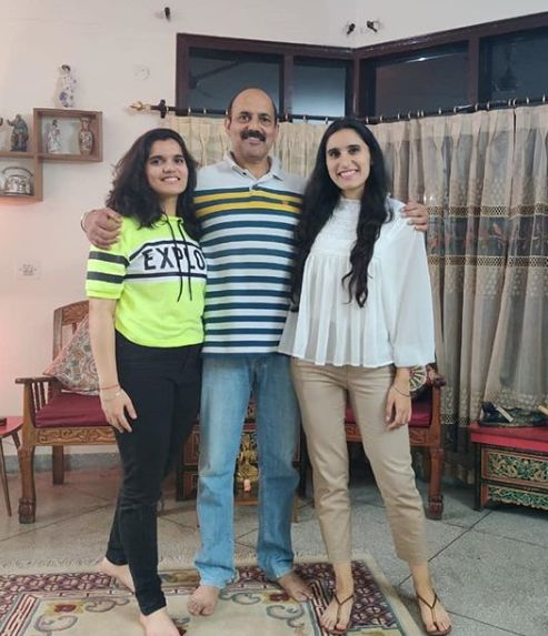Srishti Sudhera with her sister and father