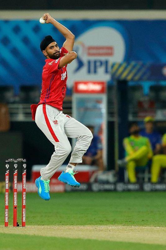 Harpreet Brar bowling during an IPL match