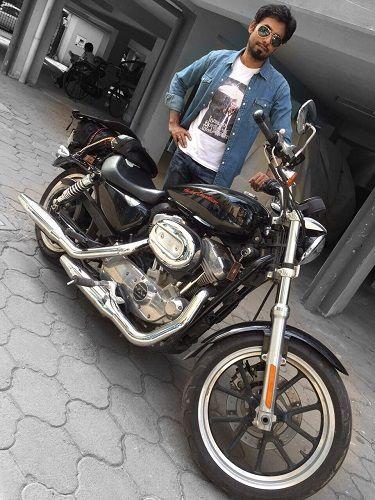 Aari Arjuna With His Motorcycle