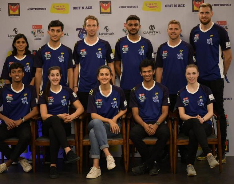 Mathias Boe and Taapsee Pannu with Pune 7 Aces team