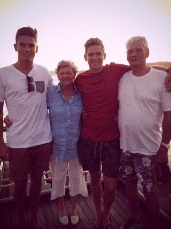 Chris Green with his mother, father Warren Green, and brother Cameron