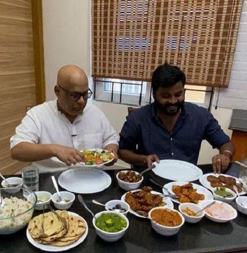 Suresh Chakravarthy Having Food at His Home