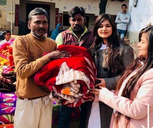 Devi Nidhi Saraswat and Devi Neha Saraswat Donating Blankets