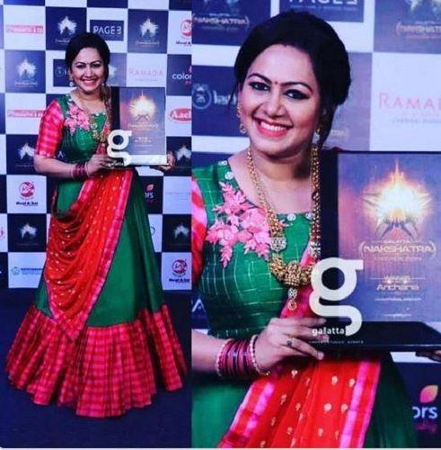 Archana Chandhoke Holding Her Award