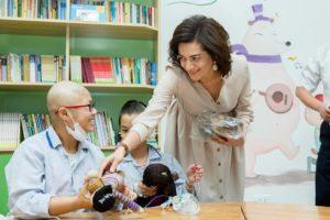Anna Hakobyan interacting with cancer-ridden children