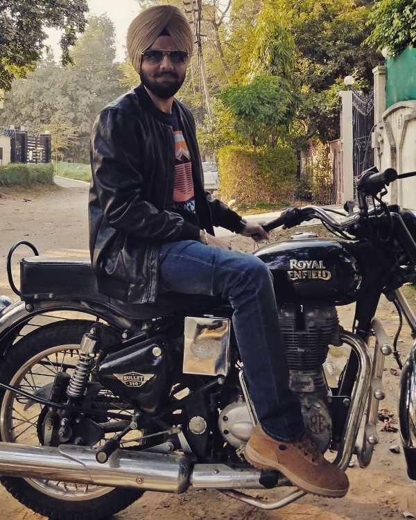 Jaspreet Singh sitting on his bike