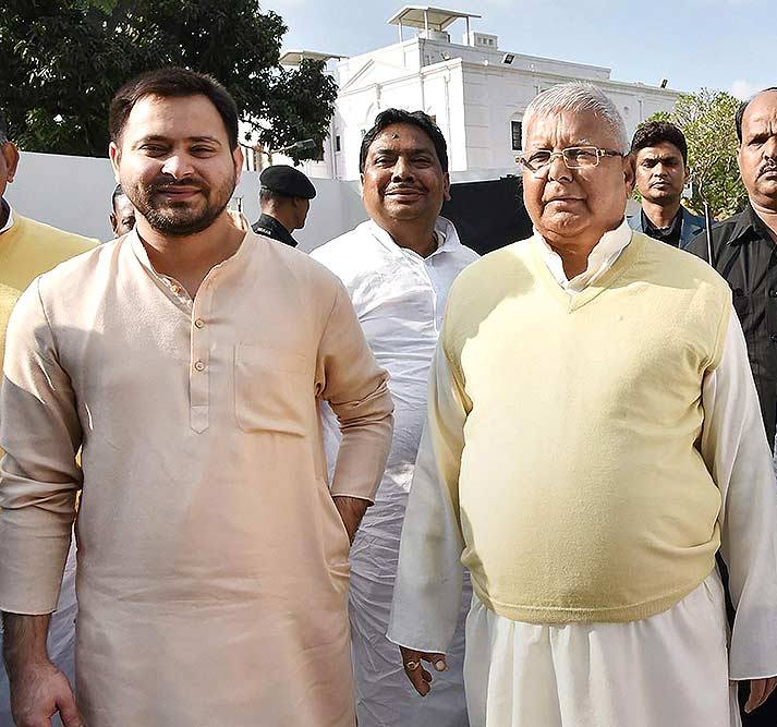 Tejashwi Yadav with his father Lalu Yadav