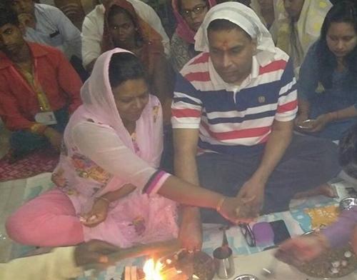 Dr. Jitendra Aggarwal and Dr. Suman Aggarwal during a praying ritual