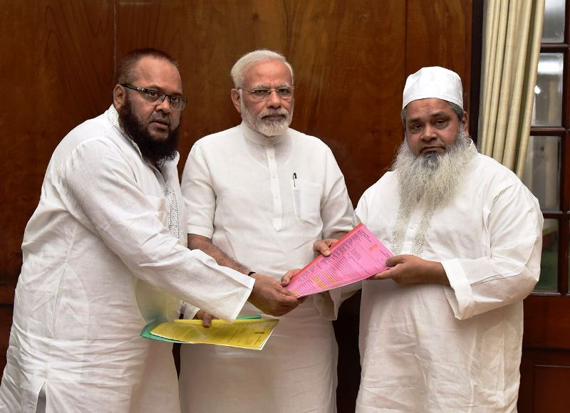 Maulana Badruddin along with his brother Mohammad Sirajuddin Ajmal presenting a memorandum to Honourable PM Modi highlighting several issues concerned with Assam