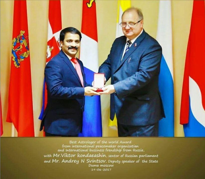 Premi Vishwanath's husband receiving an award