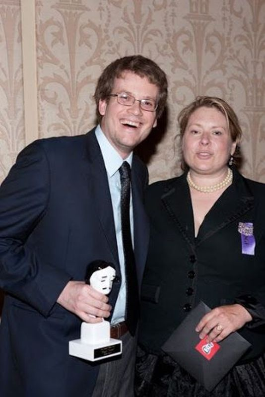 John Green holding the Edgar Allan Poe Award (Left)