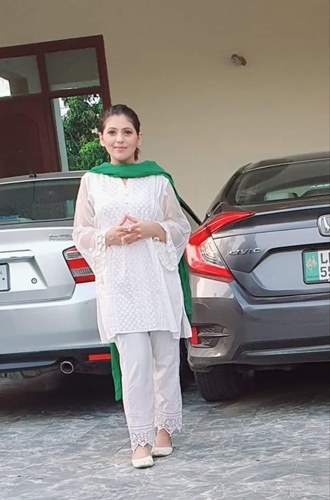 Dr. Fiza Khan with her cars