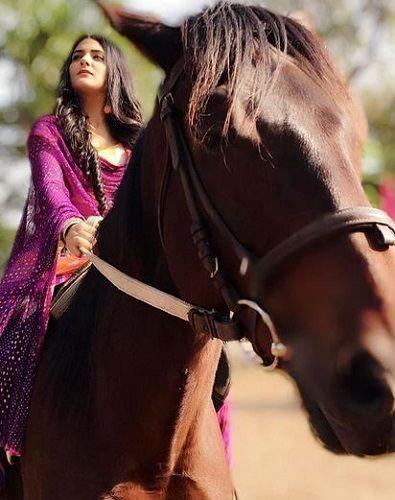 Debattama Saha Riding a Horse