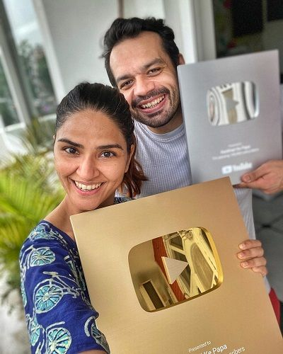 Gaurav Taneja with his Wife Holding YouTube Play Buttons