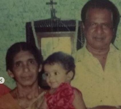 Anna Ben with her grandparents
