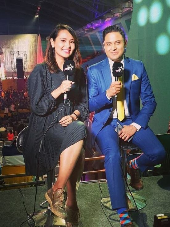 Anant Tyagi working as a commentator with his wife