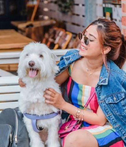 Riya Jain with a dog