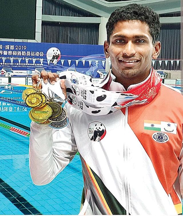 Sajan Prakash showing his Gold medals