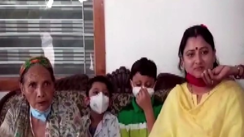 Pushkar Singh Dhami's mother, wife, and kids celebrating his victory