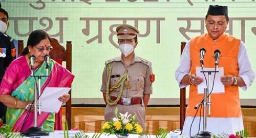 Pushkar Singh Dhami taking oath with the governor Baby Rani Maurya