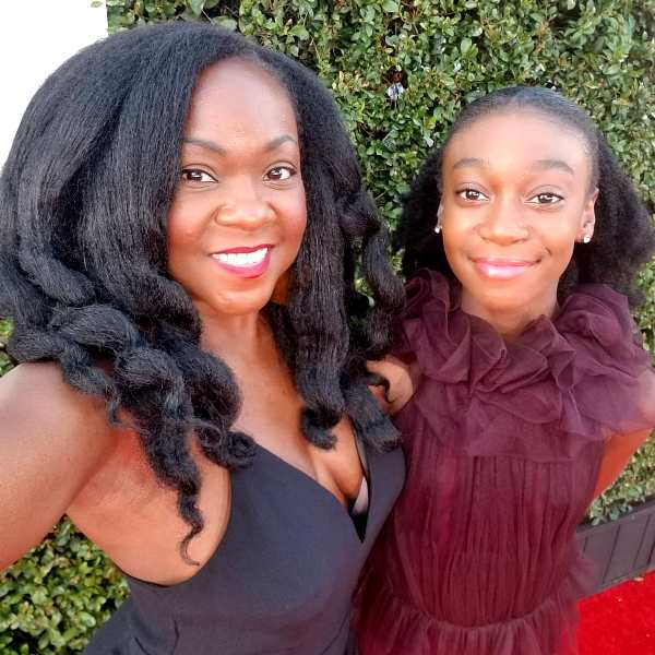 Shahadi Wright with her mother