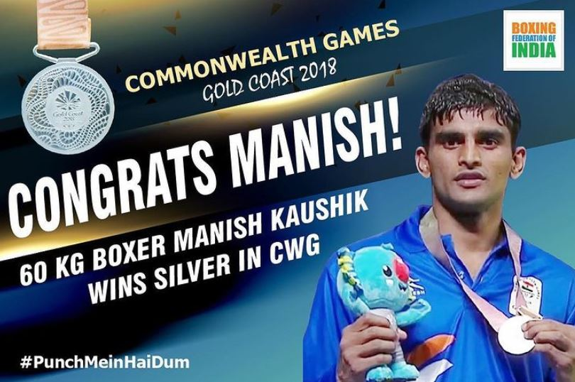 Manish Kaushik with a silver medal