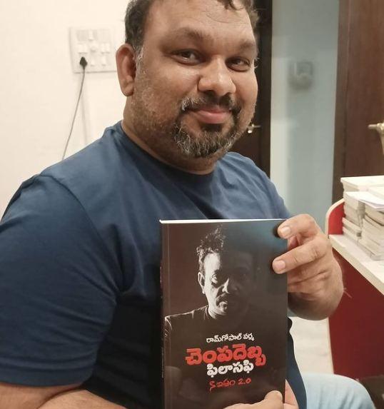 Mahesh Kathi holding the book Slap Philishopy