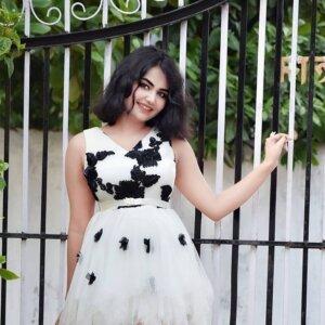 Geethika Jeshwi in white gown
