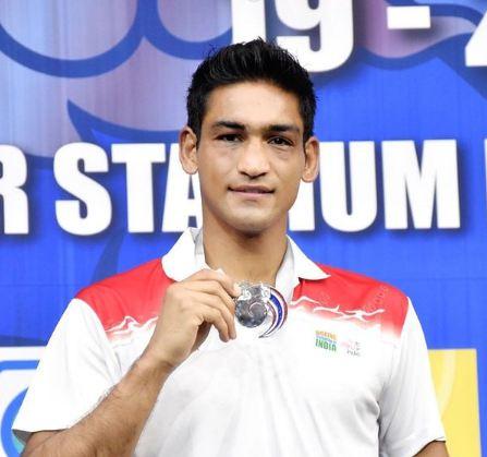 Ashish Kumar with a silver medal