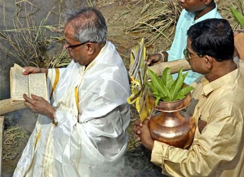 Pranab Mukherjee conducting Durga Puja with Abhijit Mukherjee at their ancestral village