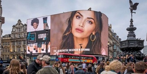 Diipa Khosla's picture on a billboard in Piccadilly Circus