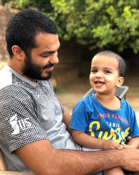 Vikas Krishan Yadav with his son
