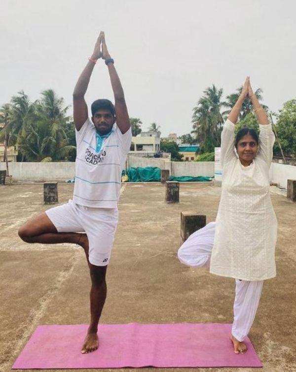 Satwiksairaj Rankireddy practising yoga with his mother