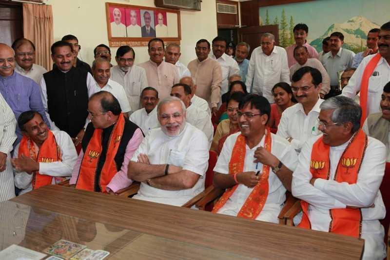 Mansukh Mandaviya with Narendra Modi and other politicians after becoming a Rajya Sabha member