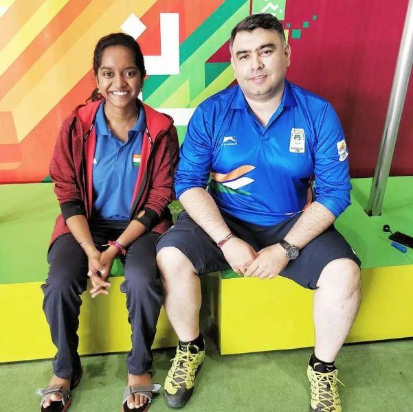 Elavenil Valarivan with her coach Gagan Narang