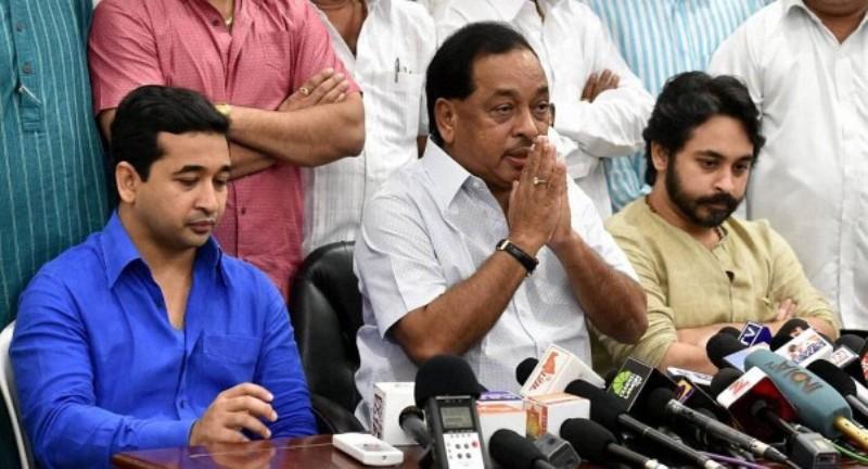 Congress leader Narayan Rane with his sons Nitesh and Nilesh during a press conference in Mumbai