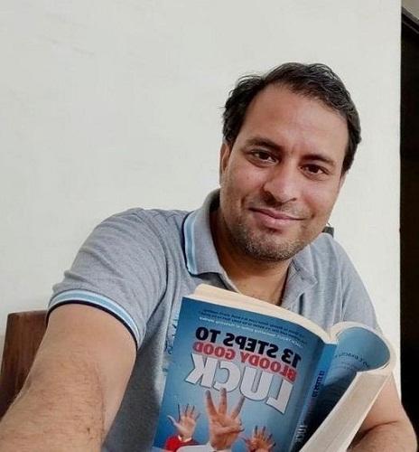 Sanjeev Rajput while reading a book