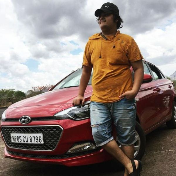 Luv Vispute standing infront of his car