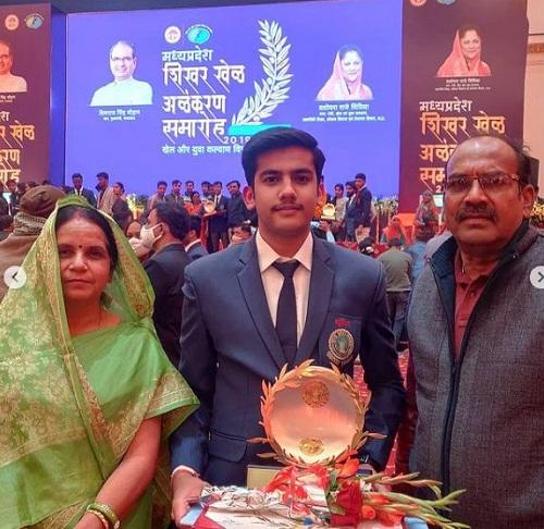 Aishwary Pratap Singh Tomar with his parents