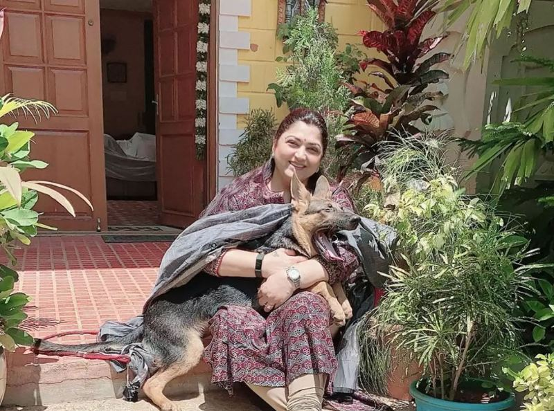 Khushbu Sundar with one of her pet dogs