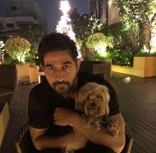 Shakeel Ladak and his pet dog