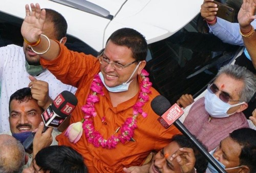 Pushkar Singh Dhami celebrating his appointment as the new Chief Minister of Uttarakhand