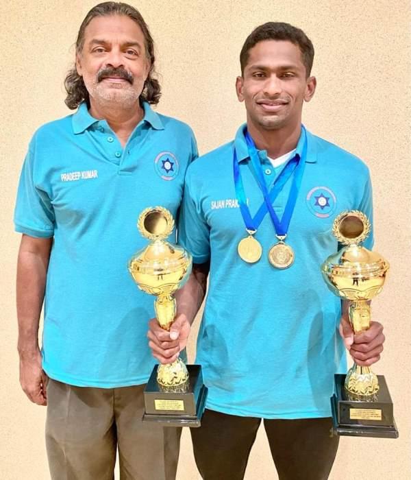 Sajan Prakash with his coach