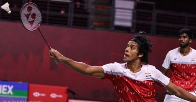 Chirag Shetty using a Voltric 80 E-tune badminton racket during a tournament