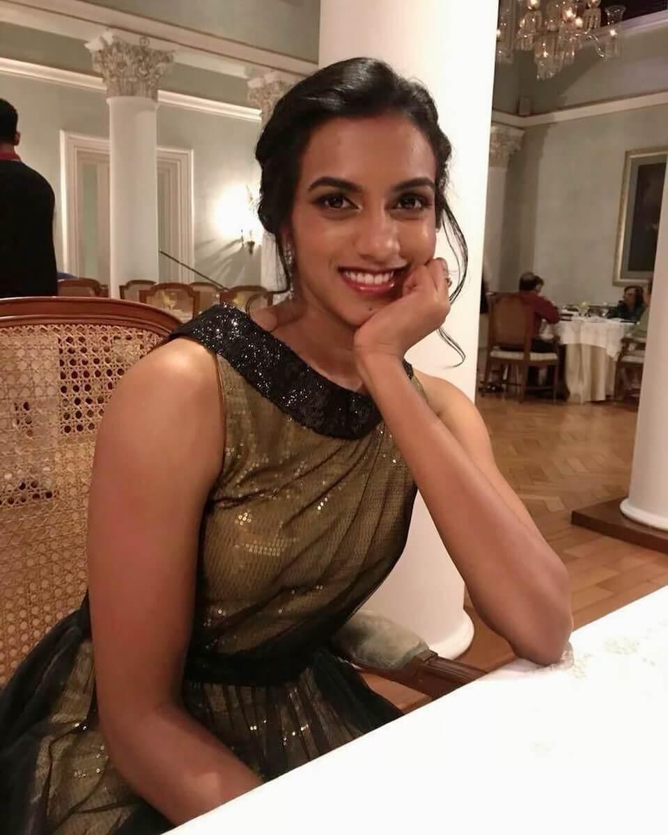 PV Sindhu in golden dress