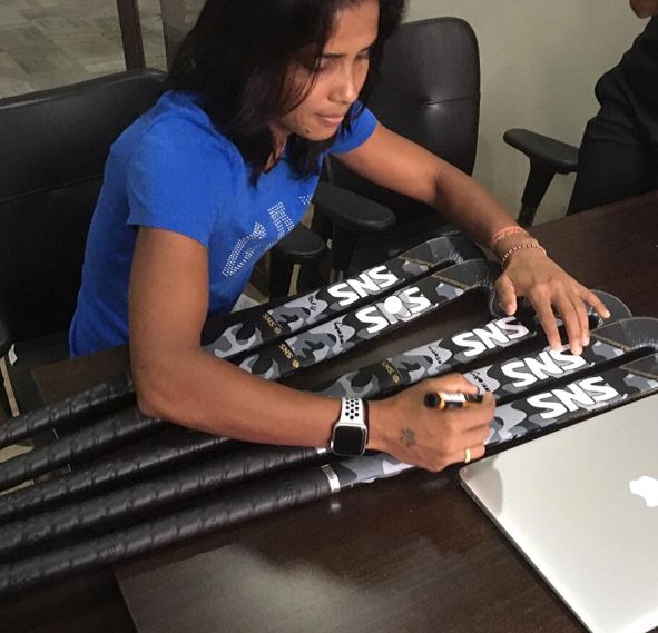 Vandana Katariya signing SNS ProTour Hockey sticks for her fans