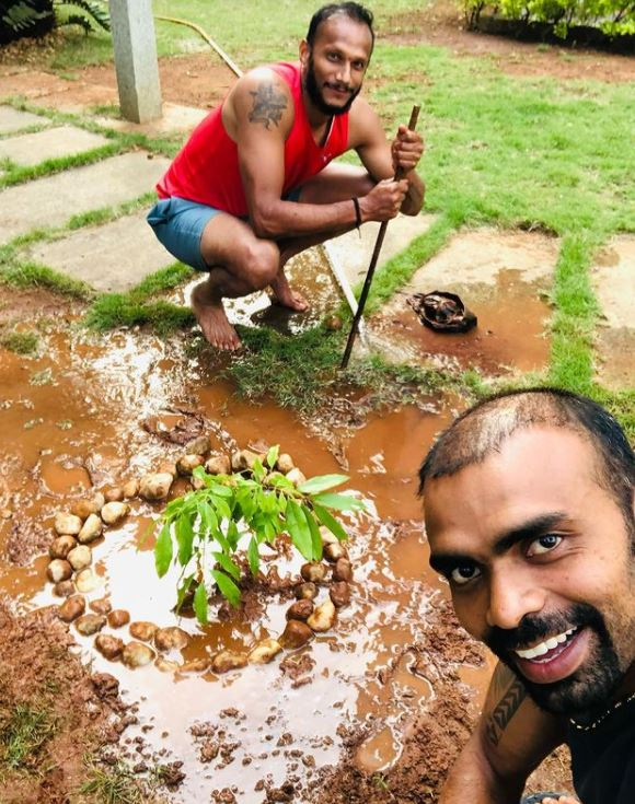 P. R. Sreejesh planting a tree